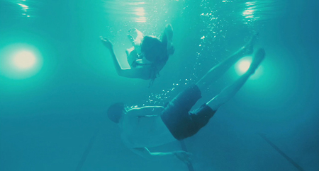 "Luke Kirby and Michelle Williams underwater in ""Take this Waltz"""